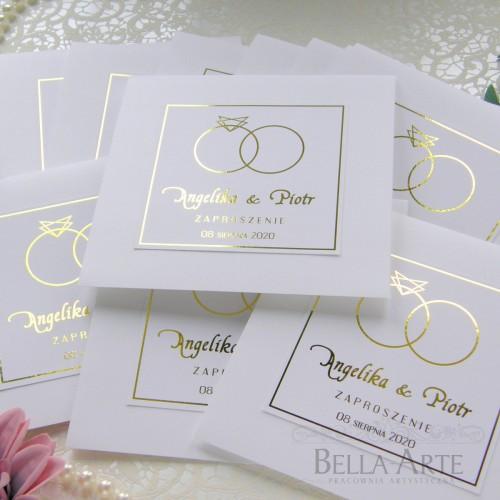 Złocone zaproszenia ślubne obrączki